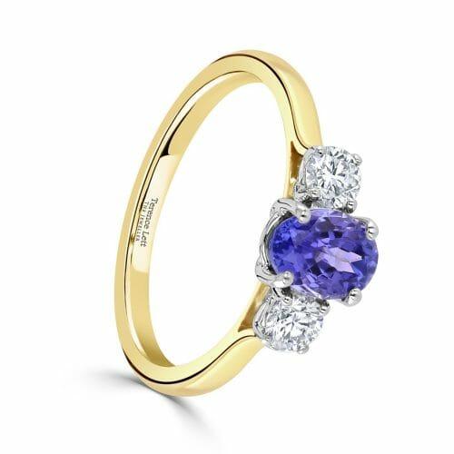 Oval Cut Tanzanite & Round Brilliant Cut Diamond Three Stone Ring