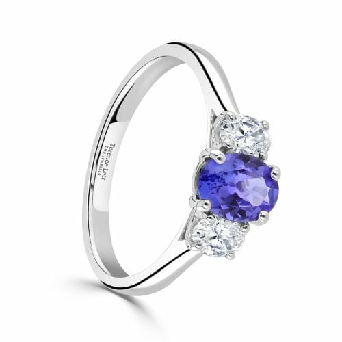 18ct White Gold Oval Cut Tanzanite & Diamond Three Stone Ring