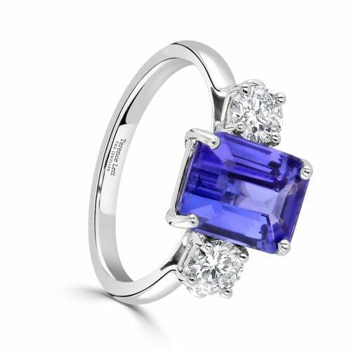 18ct White Gold Octagon Cut Tanzanite & Round Brilliant Cut Diamond Three Stone Ring