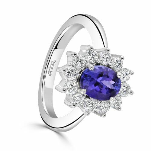 18ct White Gold Oval Cut Tanzanite & Round Brilliant Diamond Cluster Ring