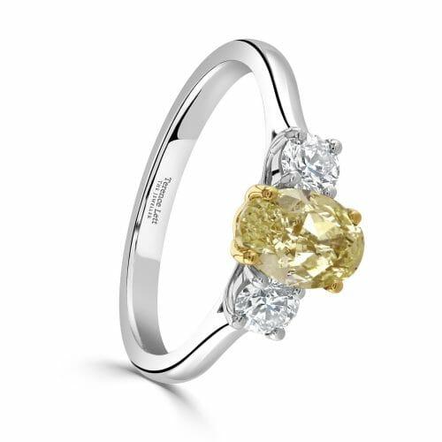 Platinum Oval Cut Yellow Diamond & Round Brilliant White Diamond Three Stone Ring