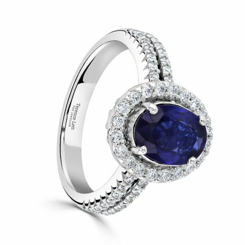 18ct White Gold Oval Cut Sapphire & Round Brilliant Diamond Cluster Ring With Diamond Set Shoulders