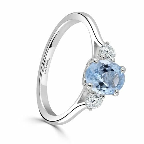 18ct White Gold Oval Cut Aquamarine & Round Brilliant Diamond Three Stone Ring